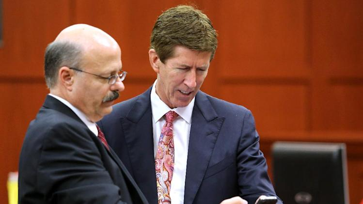 Prosecutor Bernie de la Rionda, left, and defense attorney Mark O'Mara confer during the 15th day of the George Zimmerman trial in Seminole circuit court, in Sanford, Fla., Friday, June 28, 2013. Zimmerman has been charged with second-degree murder for the 2012 shooting death of Trayvon Martin.(AP Photo/Orlando Sentinel, Joe Burbank, Pool)