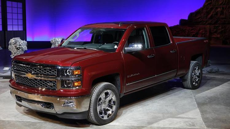 General Motors displays its 2014 Chevrolet Silverado full-size pickup truck after unveiling it and the 2014 GMC Sierra full-size pickup in Pontiac, Michigan