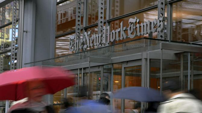 In this Wednesday, Oct. 10, 2012, photo, people pass the New York Times building in New York. The Newspaper Association of America, the New York Times Co. and several other newspaper companies have filed papers in support of a lawsuit filed by The Associated Press against Meltwater, a company that monitors the media for corporate customers. (AP Photo/Richard Drew)