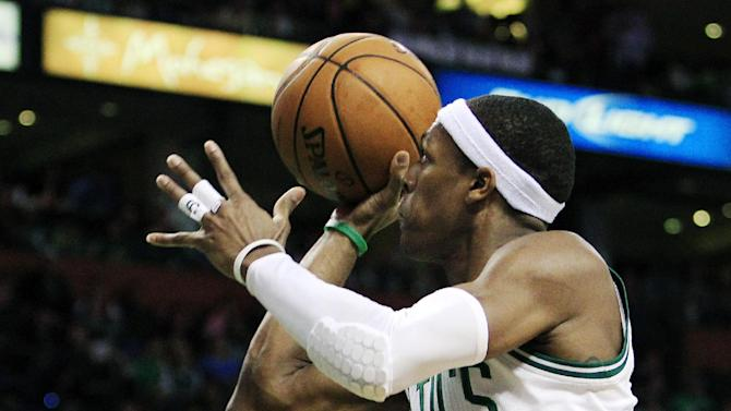 Boston Celtics guard Rajon Rondo, right, shoots over Miami Heat forward Shane Battier, left, during the second quarter of Game 4 in their NBA basketball Eastern Conference finals playoff series in Boston, Sunday, June 3, 2012. (AP Photo/Elise Amendola)