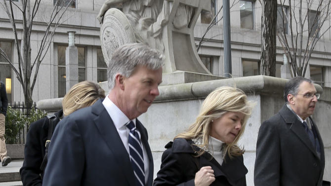Ron Johnson, left, CEO of J.C. Penney, arrives at New York Supreme Court, Friday, March 1, 2013.    Johnson is expected to testify in a trial that pits the struggling department store chain against rival Macy's Inc. over a partnership with Martha Stewart. The trial focuses on whether Macy's has the exclusive right to sell some of Martha Stewart branded products such as cookware, bedding and bath items. Macy's is seeking to block Penney from opening Martha Stewart mini shops in its stores. The shops are part of Johnson's big plan to reinvent the shopping experience at the beleaguered chain.  (AP Photo/Bebeto Matthews)