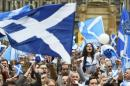 Campaigners wave Scottish Saltires at a 'Yes' campaign rally in Glasgow
