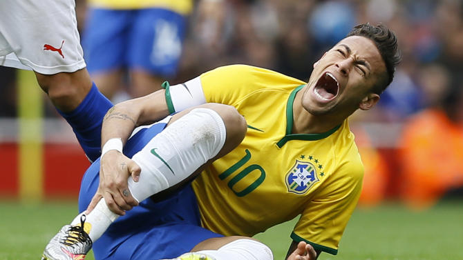 Brazil's Neymar reacts after a foul by Chile's Miko Albornoz, during the international friendly soccer match soccer match between Brazil and Chile at the Emirates stadium in London, Sunday, March 29, 2015. (AP Photo/Kirsty Wigglesworth)