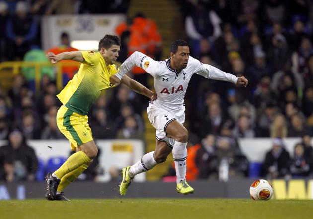 Tottenham Hotspur's Moussa Dembele has his shirt pulled by Anzhi Makhachkala's Ilya Maksimov during their Europa League soccer match at White Hart Lane, London