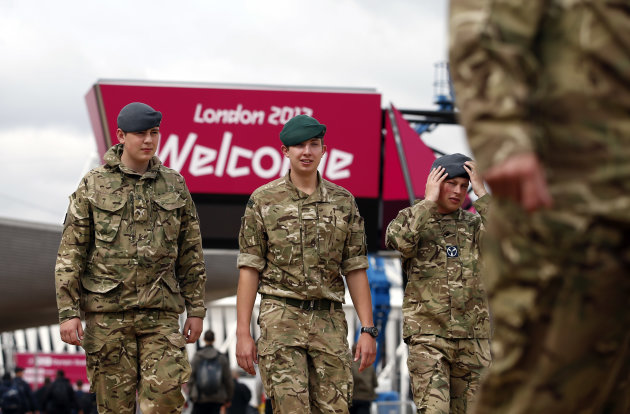 British military personnel walk near the Aquatics Center at the Olympic Park, Wednesday, July 18, 2012, in London. Opening Ceremonies for the London Olympics will be held Friday July 27, 2012. (AP Photo/Jae C. Hong)