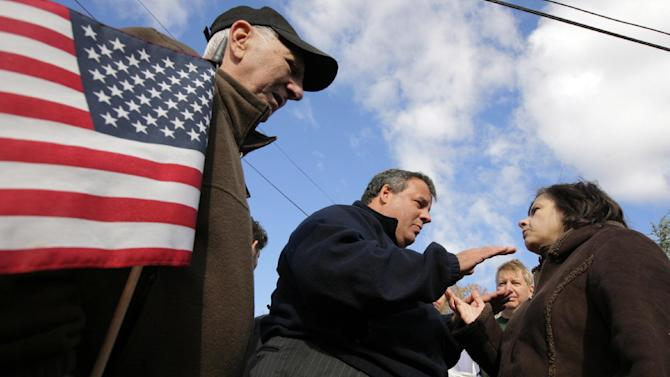 New Jersey Gov. Chris Christie, center, talks with Lamker Court resident Pauline Meneses, 53, right, as Joe Mangino, 77, looks on, Saturday, Nov. 3, 2012, in Little Ferry, N.J. Christie toured a section of Little Ferry that was flooded when Superstorm Sandy caused a tidal surge on the Hackensack River that overtook a natural berm protecting the town. (AP Photo/The Star-Ledger, David Gard, Pool)