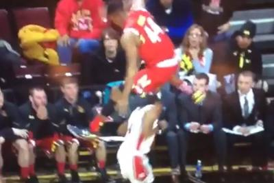 Maryland's Dez Wells forces a travel by jumping clear over a Rutgers player's head