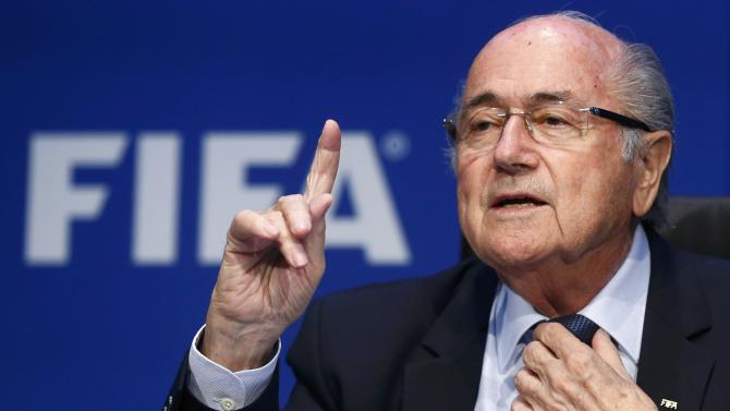 Re-elected FIFA President Blatter gestures during a news conference after an extraordinary Executive Committee meeting in Zurich