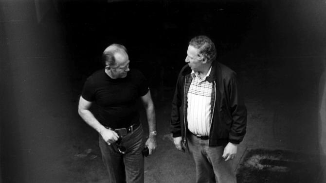 "This 1980 black and white surveillance photo released by the U.S. Attorney's Office and presented as evidence during the first day of a trial for James ""Whitey"" Bulger in U.S. District Court in Boston, Wednesday, June 12, 2013, shows Bulger, left, with George Kaufman at a Lancaster Street garage in Boston's North End. Bulger is on trial for a long list of crimes, including extortion and playing a role in 19 killings. (AP PhotoU.S. Attorney's Office)"