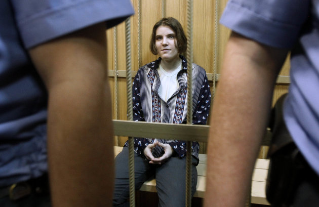"FILE - In this June 20, 2012 file photo, Yekaterina Samutsevich, a member of the feminist punk band Pussy Riot, sits in a district court in Moscow. The trial of feminist punk rockers who chanted a ""pu"