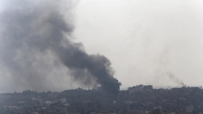 Smoke from Israeli strikes rises over Gaza City , northern Gaza Strip, Monday, July 21, 2014. The first major ground battle in two weeks of Israel-Hamas fighting exacted a steep price Sunday: It killed 65 Palestinians and 13 Israeli soldiers and forced thousands of terrified Palestinian civilians to flee Gaza City's Shijaiyah neighborhood, reportedly used to launch rockets at Israel and now devastated by the fighting. (AP Photo/Lefteris Pitarakis)