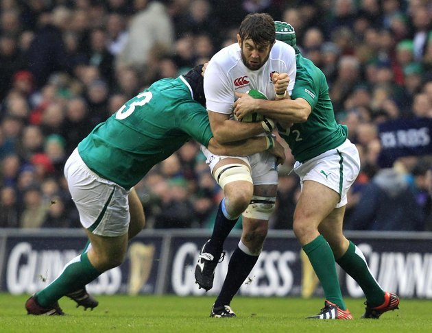 England's Geoff Parling is challenged by Ireland's Mike Ross and Rory Best during their Six Nations rugby match at Aviva stadium in Dublin