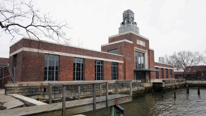 FILE - This March 26, 2007 file photo shows the ferry building on Ellis Island, N.J. The National Parks Service says the Ellis Island Immigration Museum will reopen to the public on Monday, Oct. 28, 2013. It's been about a year since Superstorm Sandy brought water levels as high as 8 feet to the iconic former U.S. immigration entry point. (AP Photo/Mike Derer, File)