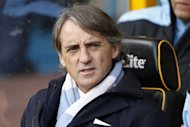 Manchester City's Italian manager Roberto Mancini awaits kick off during an English Premier League football match between Wolverhampton Wanderers and Manchester City at Molineux Stadium in Wolverhampton, England. Manchester City made the most of Manchester United dropping points against Everton on Sunday to move within three points of the Premier League leaders by beating Wolves