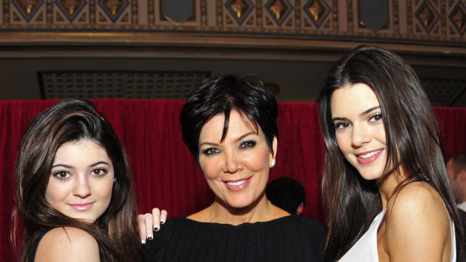 From left, Kylie Jenner, Kris Jenner and Kendall Jenner attend the Red Dress Collection 2013 Fashion Show, on Wednesday, Feb. 6, 2013 in New York. (Photo by Charles Sykes/Invision/AP)