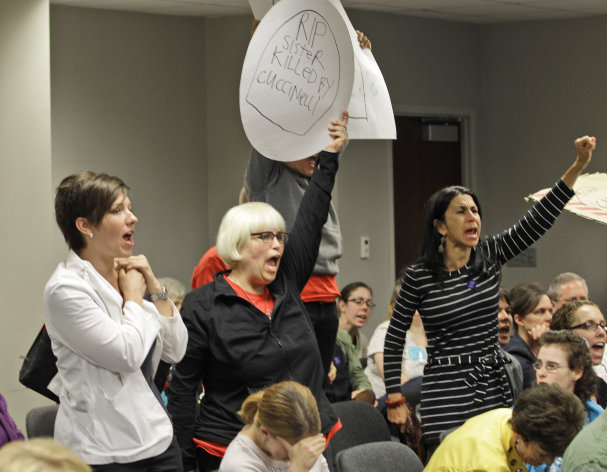 Anti-abortion advocates scream at members of the Virginia Board of Health after their decision to impose new building regulations on abortion clinics in Richmond, Va., Friday, Sept. 14, 2012. The Virginia Board of Health has approved abortion clinic regulations that include the strict building standards that abortion-rights supporters opposed, saying they are meant to put the operations out of business. (AP Photo/Steve Helber)
