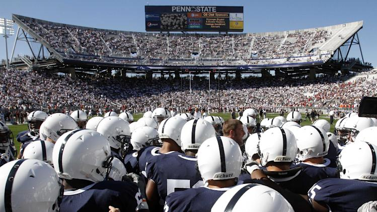 FILE - In this Sept. 25, 2010 file photo,  the Penn State football team gathers on the field before an NCAA college football game against Temple at Beaver Stadium in State College, Pa. The NCAA slammed Penn State with an unprecedented series of penalties Monday, July 23, 2012, including a $60 million fine and the loss of all coach Joe Paterno's victories from 1998-2011, in the wake of the Jerry Sandusky child sex abuse scandal.  (AP Photo/Gene J. Puskar, File)
