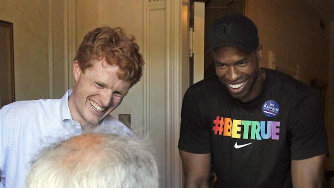 NBA veteran Jason Collins, right, the first active player in one of four major U.S. professional sports leagues to come out as gay, visits with Boston Mayor Tom Menino, seated center, alongside U.S. Rep. Joe Kennedy III, left, and former Congressman Barney Frank, at his residence along the gay pride parade route. Saturday, June 8, 2013, in Boston.  (AP Photo/Mary Schwalm)
