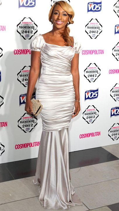 Alexandra Burke reminded us a little bit of a Christmas pressie in this satin fishtail draped gown. Copyright [Getty]