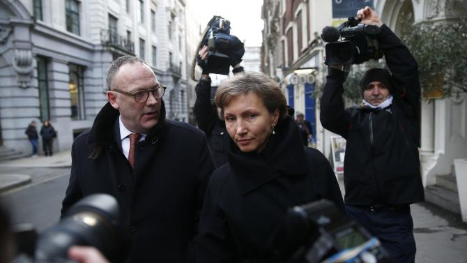 Marina Litvinenko, widow of murdered KGB agent Alexander Litvinenko is surrounded by cameras as she makes her way back to the High Court in central London