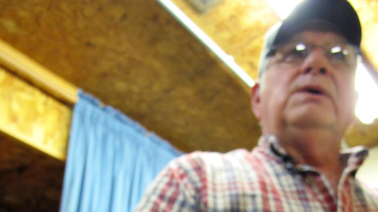 In this Sept. 18, 2012, photo Don Dobbs, owner of Buckhorn Ginseng, holds a wild ginseng root on in Richland Center, Wis. The Wisconsin Department of Natural Resources is getting more complaints about people trespassing to take the root, which can be worth as much as $600 a pound. (AP Photo/Carrie Antlfinger)