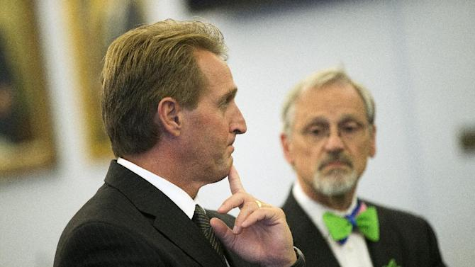 FILE - In this Oct. 9, 2013, file photo Sen. Jeff Flake, R-Ariz., left, and Rep. Blumenauer, D-Ore., take part in a news conference on the Farm Bill on Capitol Hill in Washington. Members of the House and Senate are scheduled to begin long-awaited negotiations Wednesday, Oct. 30, on the five-year, roughly $500 billion farm bill. If they don't finish it dairy supports could expire at the end of the year, sending the price of a gallon of milk skyward, and a contentious debate over food stamps could spill into election season. (AP Photo/ Evan Vucci, File)