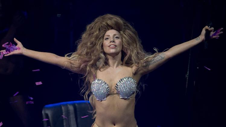 FILE - In this Sept. 1, 2013 file photo, Lady Gaga performs on stage at the Roundhouse in Camden, north London, as part of the iTunes Festival, the first of 30 nights of live free music in the capital. Lady Gaga and a former personal assistant who sued her won't face off in a trial next month after settling their differences out of court. The settlement in a lawsuit brought by Jennifer O'Neill was revealed Monday, Oct. 21, 2013, in a court order dismissing the case. (Photo by Joel Ryan/Invision,file)