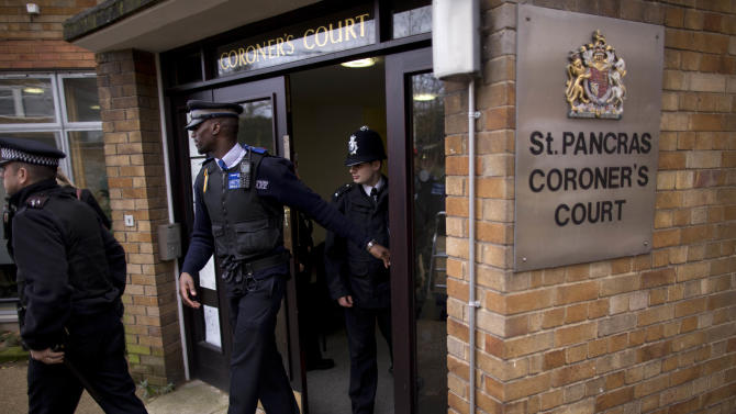 Police officers and a community support officer, center, leave after a second inquest into the death of singer Amy Winehouse at St. Pancras Coroner's Court in London, Tuesday, Jan. 8, 2013. A second coroner's inquest confirmed Tuesday, that Amy Winehouse died of accidental alcohol poisoning when she resumed drinking after a period of abstinence. The second inquest was held after the original coroner was found to lack the proper qualifications for the job.  (AP Photo/Matt Dunham)