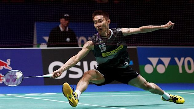 Lee Chong Wei of Malaysia returns a shot to Lee Hyun Il of South Korea during their men's singles semi-final match at the All England Badminton Championships in Birmingham, central England, March 10, 2012