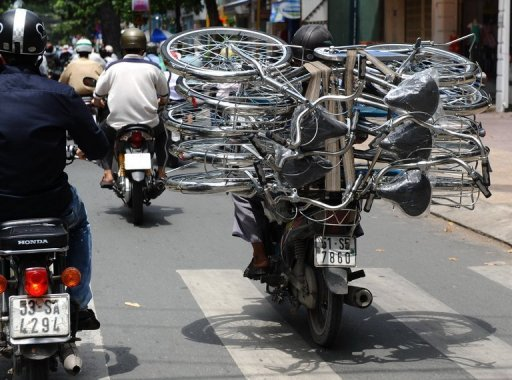 &lt;p&gt;This file photo shows a man transporting bicycles in Ho Chi Minh City. Vietnamese inflation picked up to the fastest pace in six months in November, according to official data, adding to the economic challenges facing the country&#39;s Communist rulers.&lt;/p&gt;