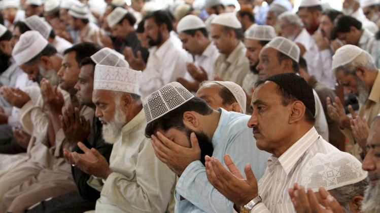 "Pakistani worshippers pray for the recovery of 14-year-old schoolgirl Malala Yousufzai, who was shot on Tuesday by the Taliban for speaking out in support of education for women, during Friday prayers in a Mosque in Karachi, Pakistan, Friday, Oct. 12, 2012. A Pakistani military spokesman says Yousufzai is in ""satisfactory"" condition but cautions that the next few days will be critical. (AP Photo/Fareed Khan)"
