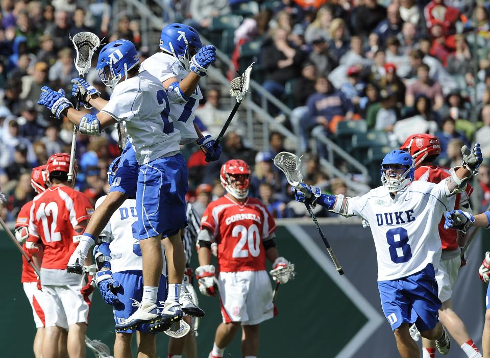 Duke's Jake Tripucka, center, celebrates with David Lawson, left, and Josh Dionne (8) after scoring a goal during the second half of an NCAA college Division 1 semifinal lacrosse game against Cornell, Saturday, May 25, 2013, in Philadelphia. Duke won 16-14. (AP Photo/Michael Perez)