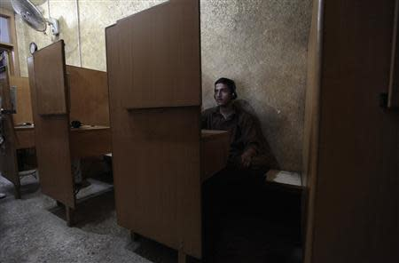 A man sits at an internet cafe in Rawalpindi