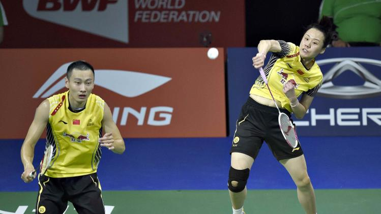 Zhang Nan and Zhao Yunlei of China play against Sudket Prapakamol and Saralee Thoungthongkam of Thailand during their mixed doubles quarter-final match at the Badminton World Championship in Copenhagen