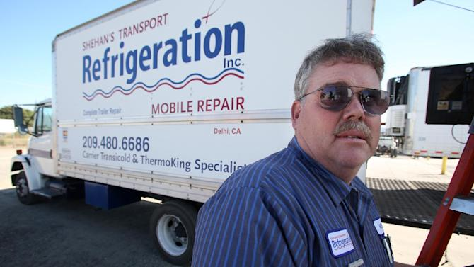 This photo taken Oct. 25, 2012 shows Kelly Cox, co-owner of Shehan's Transport Refrigeration in Delhi, Calif. Who are these people who still can't make up their minds? They're undecided voters like Cox, who spends his days repairing the big rigs that haul central California's walnuts, grapes, milk and much more across America. He doesn't put much faith in Barack Obama or Mitt Romney.  (AP Photo/Gary Kazanjian)