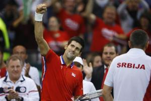 Serbia's Djokovic celebrates winning a set against Czech Republic's Berdych during their Davis Cup World Group final tennis match in Belgrade