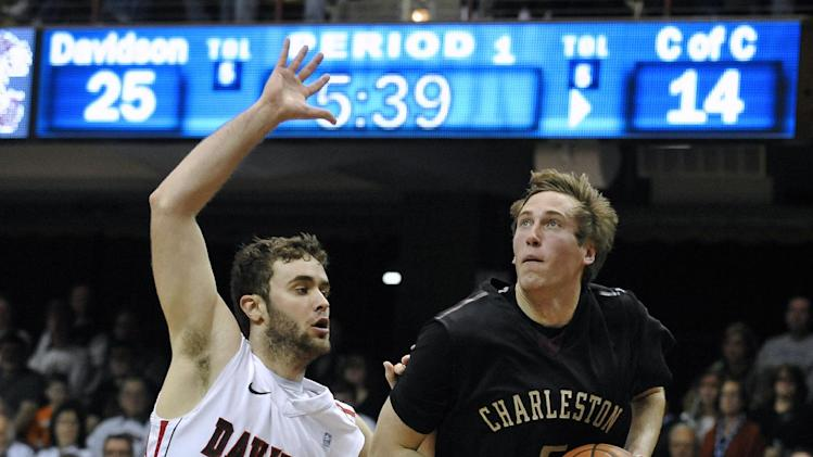 College of Charleston's Matt Sundberg (5) drives for a basket as Davidson's Tom Droney (23) defends in the first half of an NCAA basketball game during the Southern Conference tournament on Monday, March 11, 2013 in Asheville, N.C. (AP Photo/Rainier Ehrhardt)