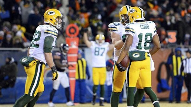 Green Bay Packers players celebrate reaching the play-offs (Reuters)