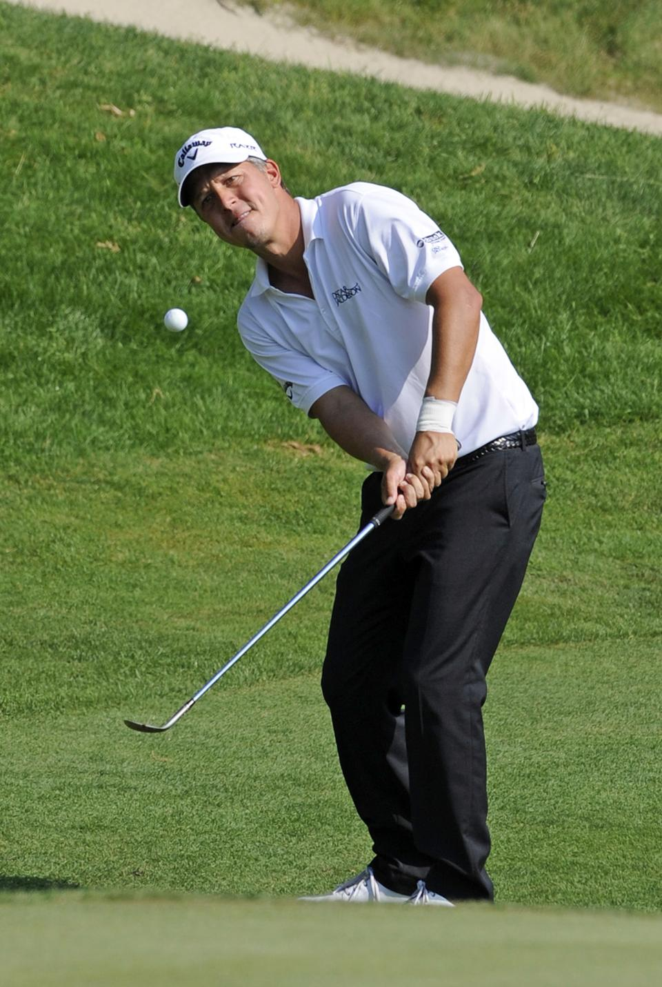 Frederik Jacobson, of Sweden, watches his chip-shot on the 15th hole during the first round of the Travelers Championship golf tournament in Cromwell, Conn., Thursday, June 21, 2012. Jacobson finished with a 5-under par 65. (AP Photo/Fred Beckham)