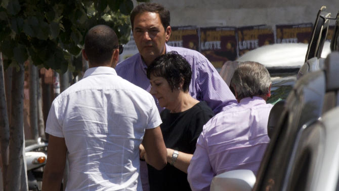 Actor James Gandolfini's sister Leta Gandolfini, at center in black, arrives with unidentified people at the morgue of the Policlinico Umberto I hospital where the body of Gandolfini is kept, in Rome, Friday, June 21, 2013. James Gandolfini died Wednesday night after suffering a cardiac arrest while vacationing with friends and relatives in Rome. (AP Photo/Alessandra Tarantino)