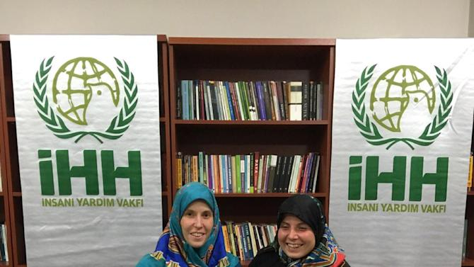 In this Friday, March 27, 2015 photo provided by IHH Humanitarian Relief Foundation, Czech tourists Hana Humpalova and Antonie Chrastecka sit in an office of the Turkish non-governmental humanitarian organization IHH in the eastern Turkish city of Van. The two tourists were abducted by gunmen two years ago as they were traveling on a bus through southwestern Pakistan have been released, the Czech government said on Saturday March 28, 2015. (AP Photo/IHH)