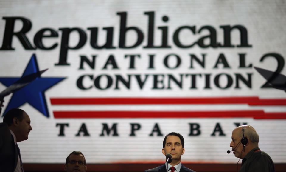 Wisconsin Gov. Scott Walker, second from right, walks up to the podium for a test in the Tampa Bay  Times Forum at the Republican National Convention in Tampa, Fla., on Sunday, Aug. 26, 2012. (AP Photo/David Goldman)
