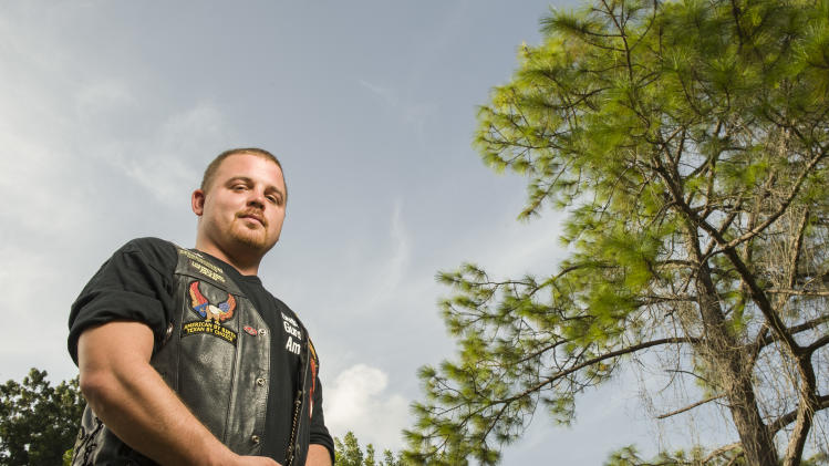 Former Marine Lance Cpl. Andrew Rothlein poses for a photograph, Thursday, July 26, 2012, in League City, Texas.   Rothlein fought in a unit in Fallujah in 2004, going building to building hunting insurgent snipers in one of the bloodiest battles of the war. (AP Photo/Dave Einsel)