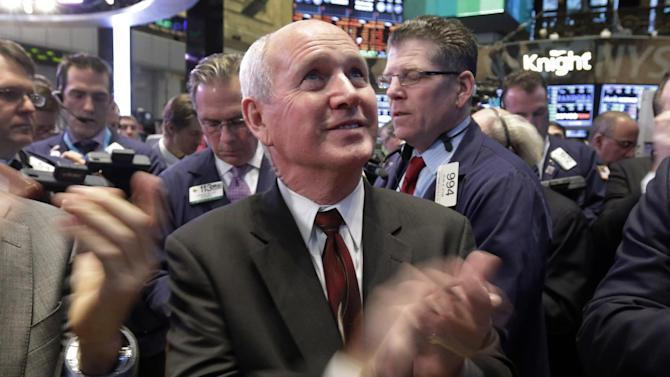Boise Cascade Chief Executive Officer Thomas Carlile, applauds during his company's IPO on the floor of the New York Stock Exchange, Wednesday, Feb. 6, 2013. Strong earnings reports from media giants Disney and Time Warner aren't impressing investors in early trading, and major U.S. market indexes are opening lower. (AP Photo/Richard Drew)