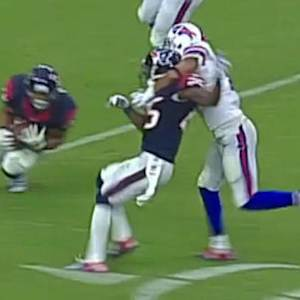Houston Texans defensive back Darryl Morris intercepts Buffalo Bills quarterback EJ Manuel