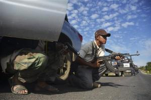 Vigilantes stand guard after hearing rumours on a possible ambush in Tierra Caliente