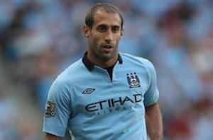 Zabaleta believes league-leading Manchester United can be caught