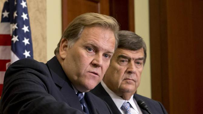 """FILE - In this Oct. 8, 2012 file photo, House Intelligence Committee Chairman Rep. Mike Rogers, R-Mich., left, and the committee's ranking Democrat, Rep. C.A. """"Dutch"""" Ruppersberger, D-Md., participate in a news conference on Capitol Hill in Washington. House lawmakers expected to finalize legislation Wednesday that would give the federal government a broader role helping banks, manufacturers and other businesses protect themselves against cyberattacks. (AP Photo/J. Scott Applewhite, File)"""
