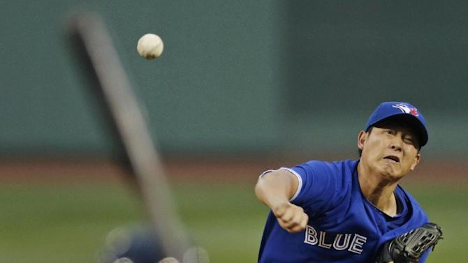 Toronto Blue Jays starting pitcher Chien-Ming Wang delivers to the Boston Red Sox during the first inning of a baseball game at Fenway Park, Thursday, June 27, 2013, in Boston. (AP Photo/Charles Krupa)