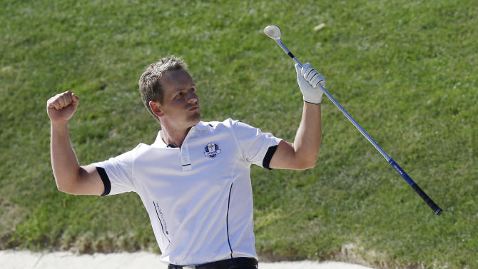 Europe's Luke Donald reacts after hitting out of a bunker on the 17th hole during a singles match at the Ryder Cup PGA golf tournament Sunday, Sept. 30, 2012, at the Medinah Country Club in Medinah, Ill. The hole gave Donald a win in the match over USA's Bubba Watson. (AP Photo/David J. Phillip)